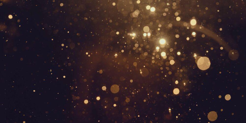 Glitter falling in a dark background
