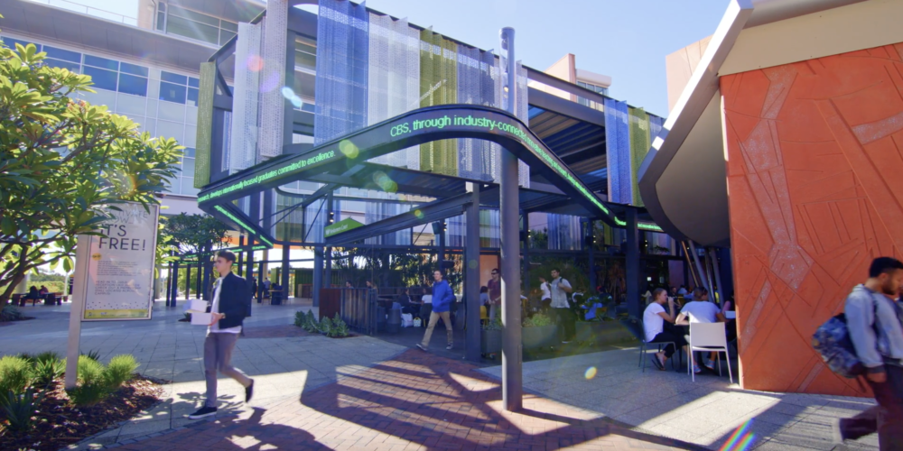 Students walking through the business and law area at Curtin University. - play video