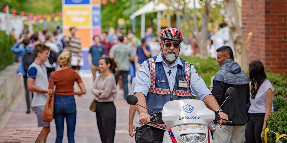 Security motorbike driving through around at Curtin Orientation Week