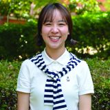 Curtin student Mojuan-Luo looking at camera and smiling
