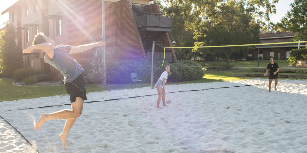 A group of students playing volleyball at Curtin accommodation - play video