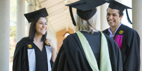 Group of Curtin university graduates in gowns laughing