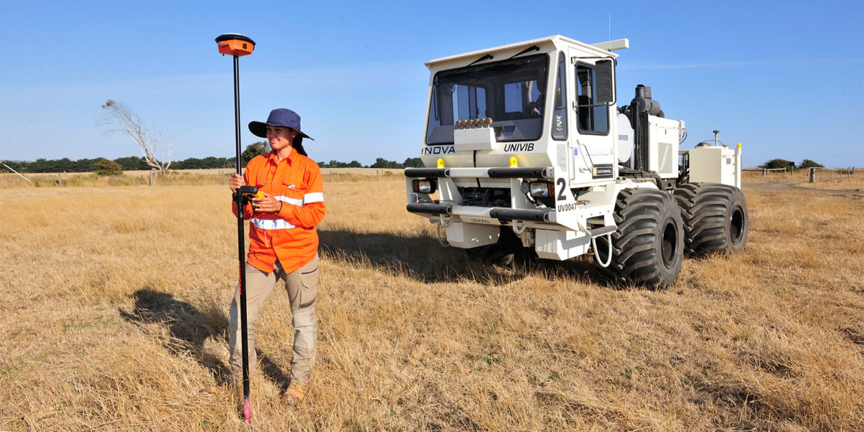 Exploration geophysics student in a field