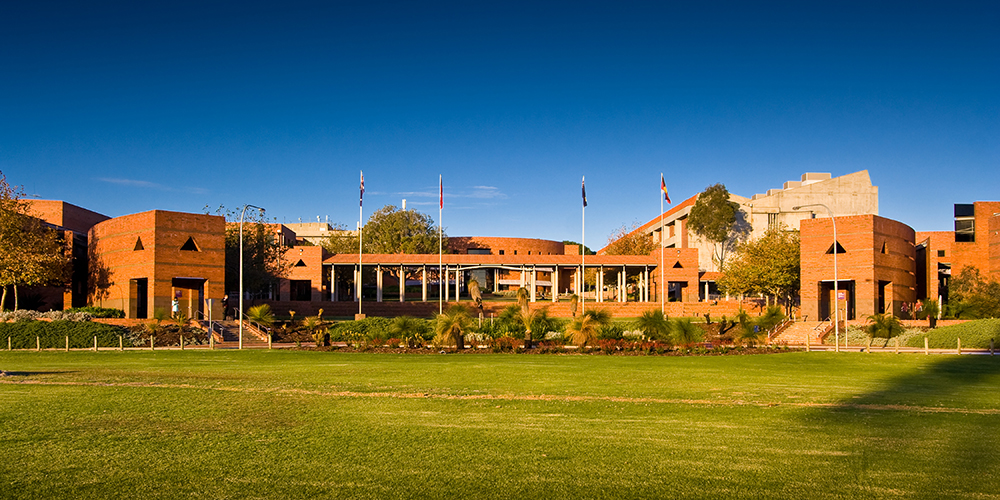 The front of Curtin building 100, taken across the grass