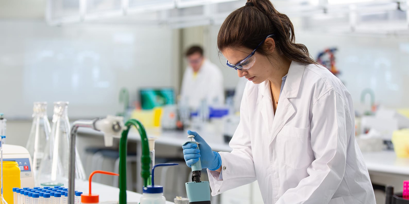 Curtin students, Jessica Murray in a lab