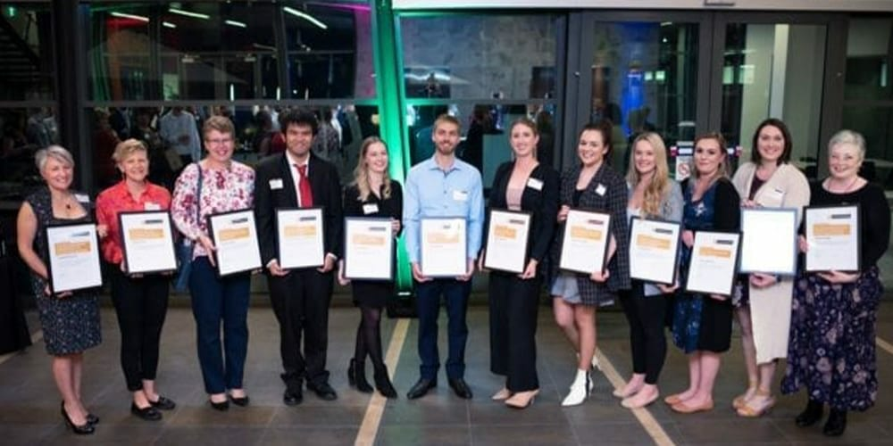 Twelve Curtin School of Education staff and students holding awards